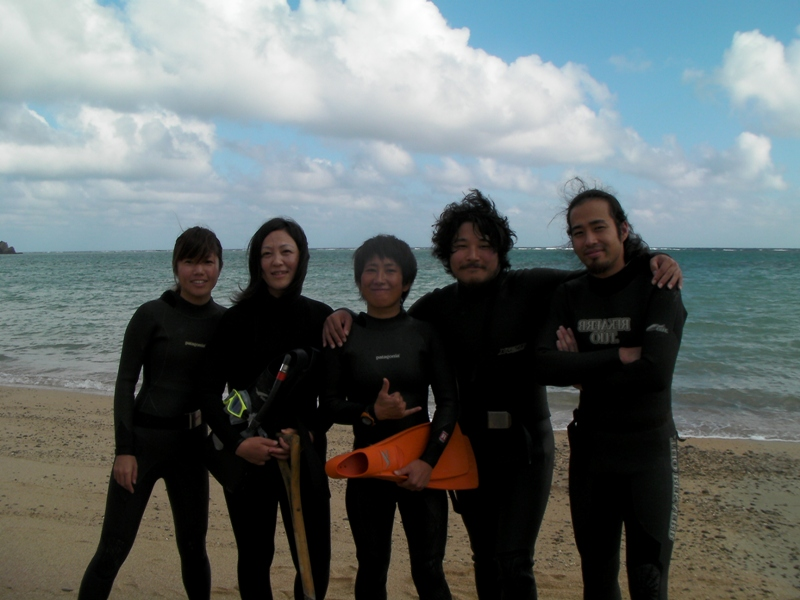 Even in warm Okinawa, it's impossible to spend all day in the water without wearing a wetsuit