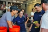 We believe that bringing a clean water solution is vital to areas in need. Here, Otto shows some Coast Guard officers how to implement the filtration systems. Photo: Ethan Lovell