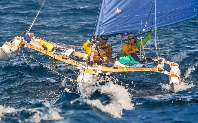 Grandson Braden steered the longest crossing of the 2017 trip, from O'ahu to Kaua'i. Photo: ©Holopuni Va'a, by Wim Lippens
