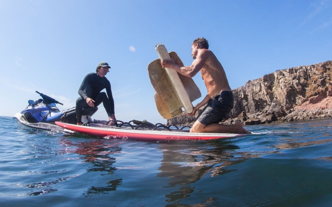Kyle Thiermann and Greg Long load up pieces of boat wreckage at Isla De Todos Santos. Baja California, Mexico. Photo: Nikki Brooks