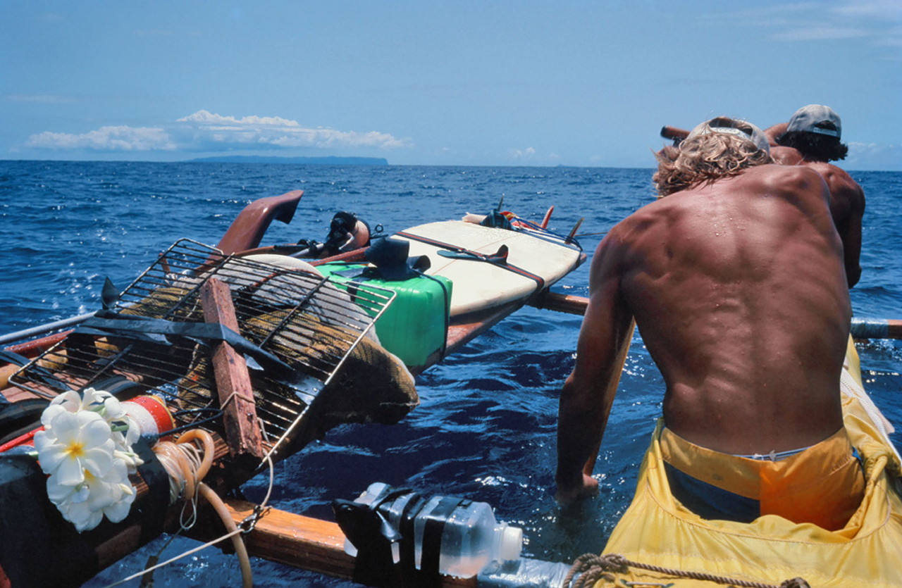 Another shot from the original voyage. When there was no wind we had to paddle. Photo: Nick Beck