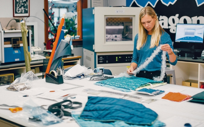 Patagonia material developer Kristin Umscheid studies PlumaFill's potential at the Patagonia headquarters in Ventura, California. Photo: Kyle Sparks