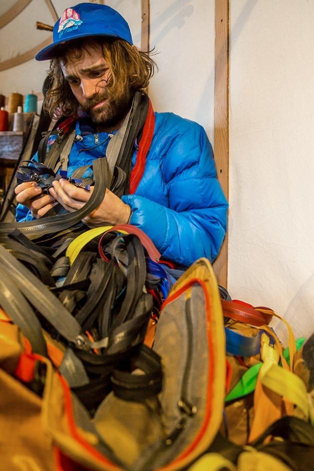 Worn Wear Repair Tech, Evan Franz, sorting out zipper options. Photo: Kern Ducote