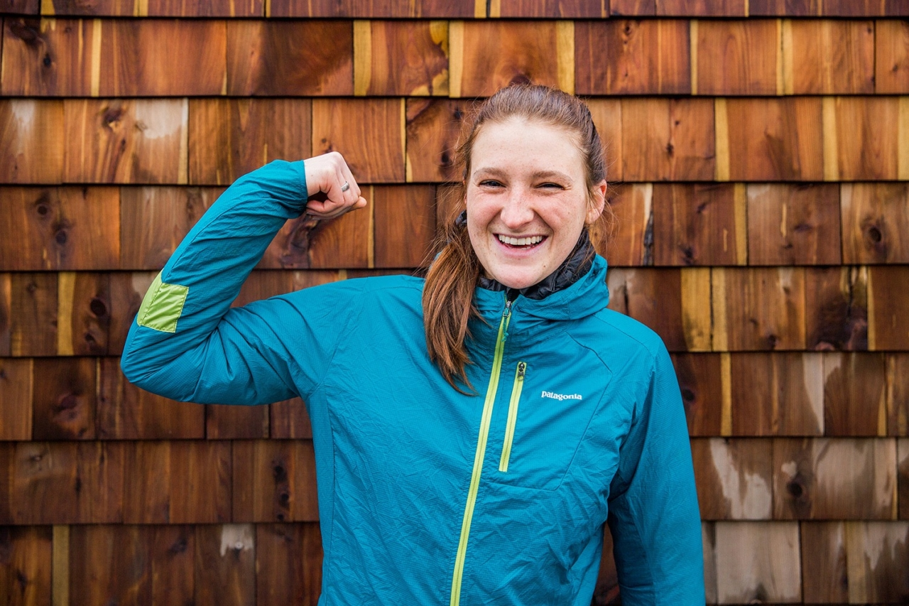 It will take more than a bike crash to slow Leah down. The Patagonia Whistler shop employee, and all around shredder, flexes to show off her repaired Houdini. Photo: Kern Ducote