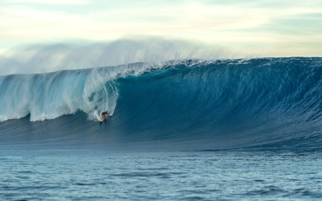 Kohl Christensen wrangling one of the forerunners as the swell began to build. Photo: Daniel Russo