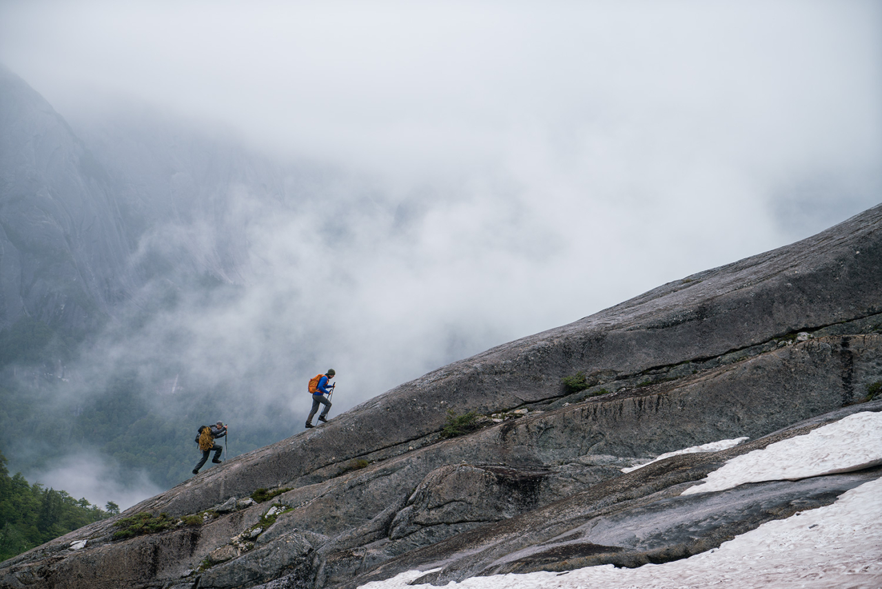 Robbie Phillips and Ian Cooper hiking to the top of La Junta. Cochamo Valley, Chile. Photo: Drew Smith
