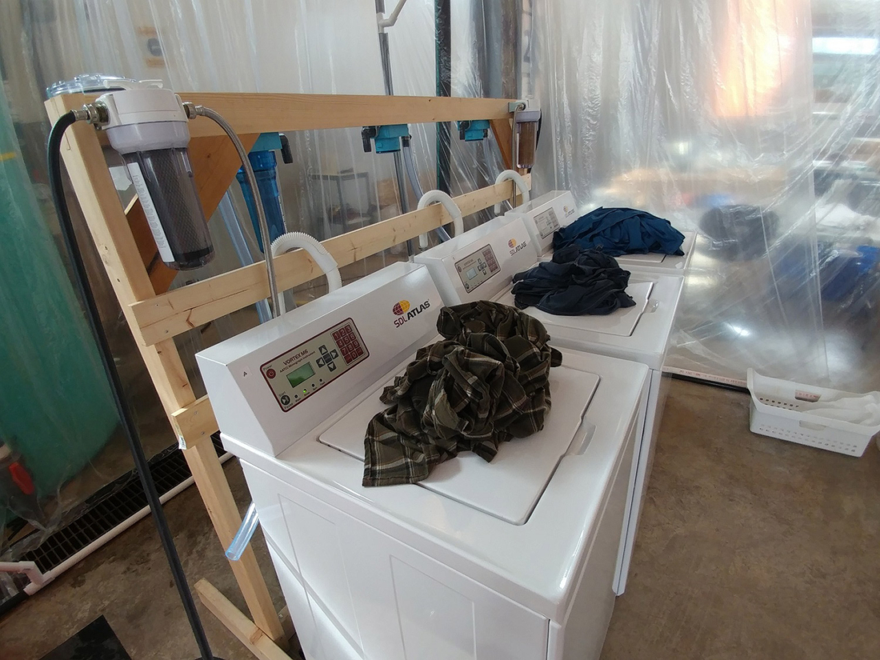 The laundry study was carried out with commercial-grade test washers that simulate a cycle in a typical home washing machine. Photo: Mathew Watkins