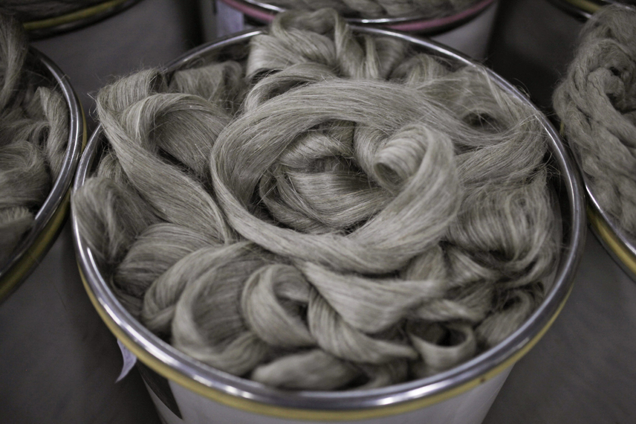 One by one, buckets fill up with strings of hemp yarn, now soft and supple enough to spin. Photo: Lloyd Belcher