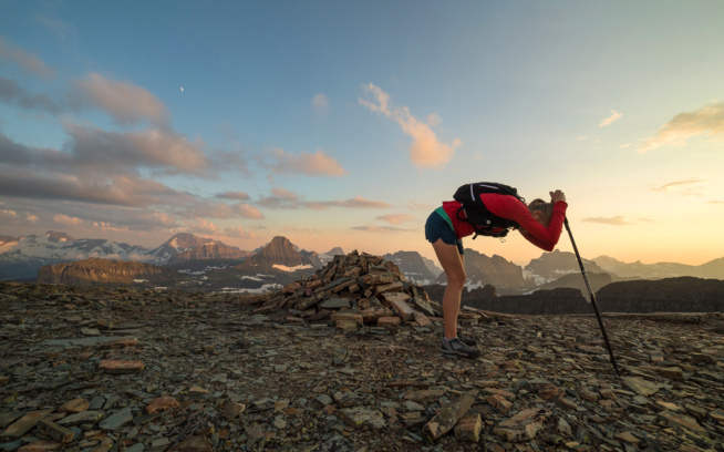 Some people will do anything to avoid pulling out a headlamp. Alyson Dimmitt Gnam catches her breath before hammering out the twilight descent to the car. Glacier National Park, Montana. Photo: Steven Gnam