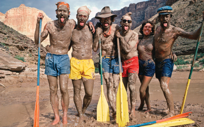 From the Fall 1984 catalog, Julie Galton and friends show off their brightly colored Baggies after rolling around in a patch of mud by the Colorado River. Photo: Chris Brown