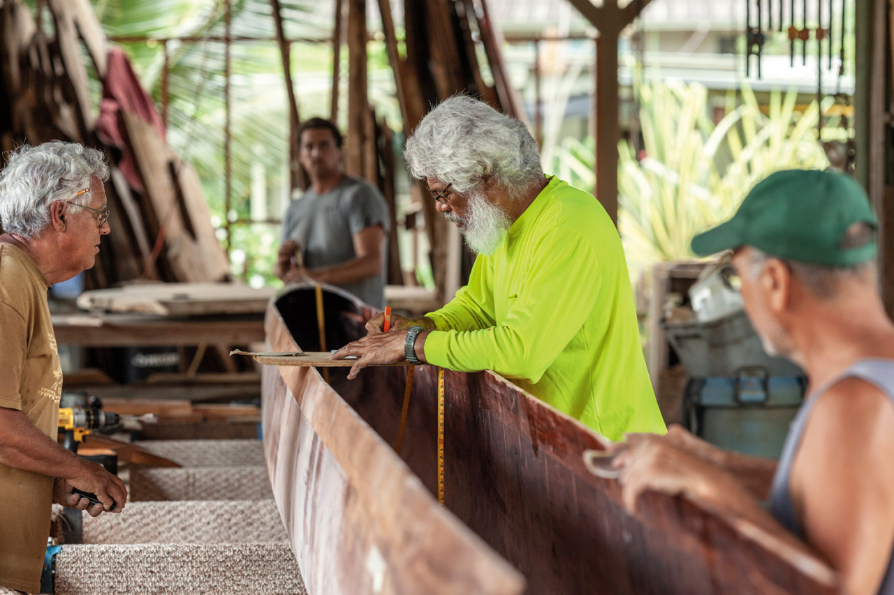 Wooden canoes are living things, with mana of their own, and working with them requires skill, understanding and respect. Uncle Myron Van Gieson puts his years of experience to work in the makeshift hālau wa'a in Hale'iwa, Hawai'i. Photo: John Bilderback