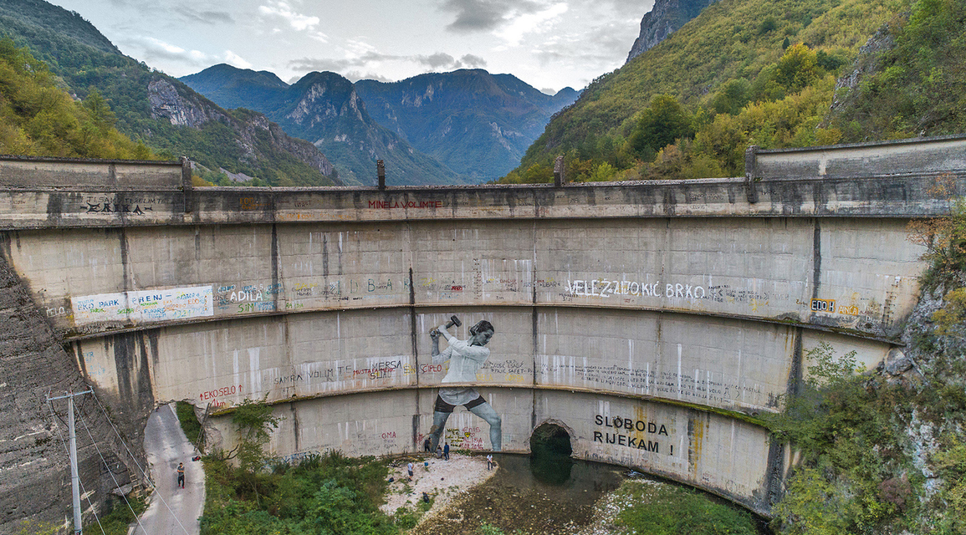Built in 1959, the Idbar Dam cracked soon after its construction. Investors and construction crews had ignored multiple warnings from the locals not to underestimate the force of the Bašćica, a river known to be unpredictable and fast-flowing. Idbar was decommissioned soon after it was constructed, when the river began fracturing the dam, allowing the Bašćica to flow freely again. Konjic, Bosnia and Herzegovina. Photo: Andrew Burr