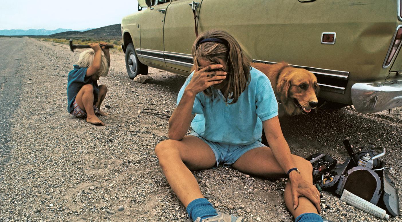The last straw. Meredith Wiltsie wiring the damn muffler en route to the Ruby Mountains, Nevada. Photo: Gordon Wiltsie