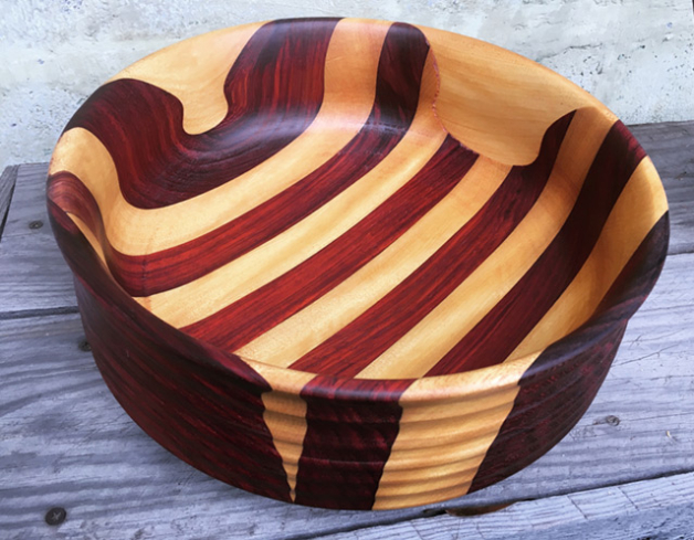 """""""In anything at all,"""" to quote Antoine de Saint-Exupéry, """"perfection is finally attained not when there is no longer anything to add, but when there is no longer anything to take away."""" Bowl made from padauk and yellowheart wood. Photo: Anni Furniss"""