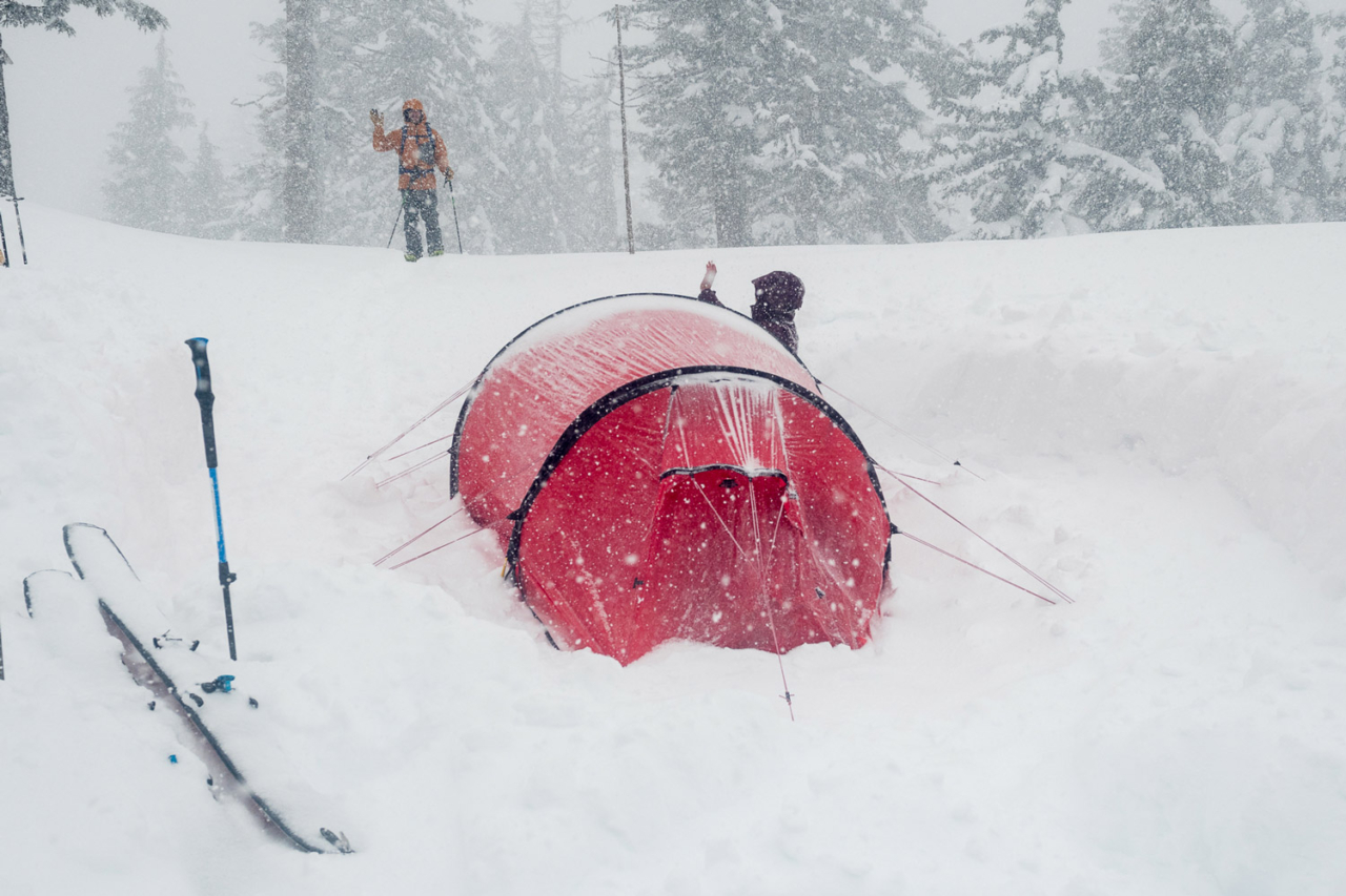 """""""Hi Kael!"""" Leah Evans greets Kael Martin as he returns from a quick foray to scope lines below camp in a whiteout. Photo: Colin Wiseman"""