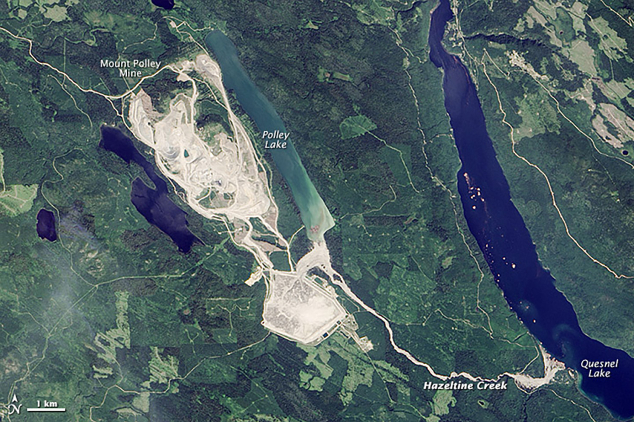 Mount Polley Mine on August 5, 2014, the day after the dam failed and nearly 350 million cubic feet of wastewater poured into Polley Lake, down Hazeltine Creek and then polluted Quesnel Lake. NASA Earth Observatory images by Jesse Allen, using Landsat data from the U.S. Geological Survey.