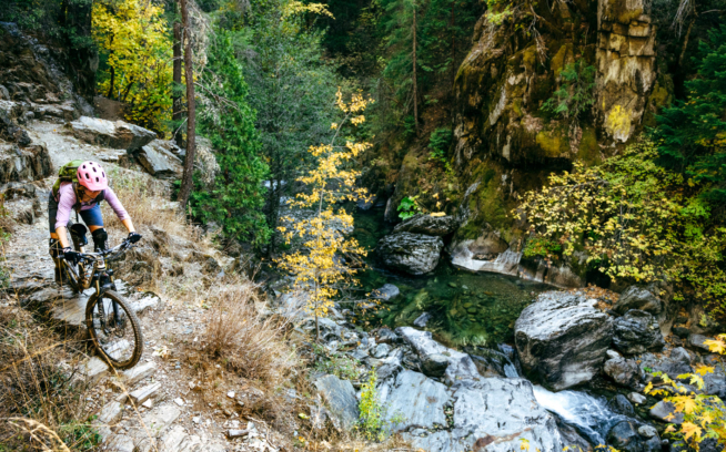 Lesser known than the First Divide and Third Divide trails, the Second Divide Trail isn't part of the Downieville Classic courses—and thus remains somewhat of a secret gem for those looking to get away from the crowds. Chelsea Jolly traverses above the swimming pools and fall colors of Second Divide. Photo: Ken Etzel