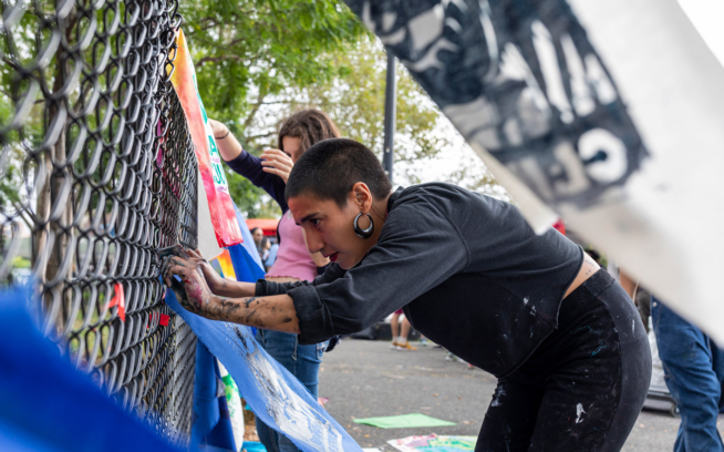 Young activists gather a week before the September 20 Global Climate Strike in New York City to build artwork, such as banners or screen-printed scraps of cotton fabric for participants to pin to their clothes. This is one of the three art builds that took place in different NYC boroughs. Photo: Keri Oberly