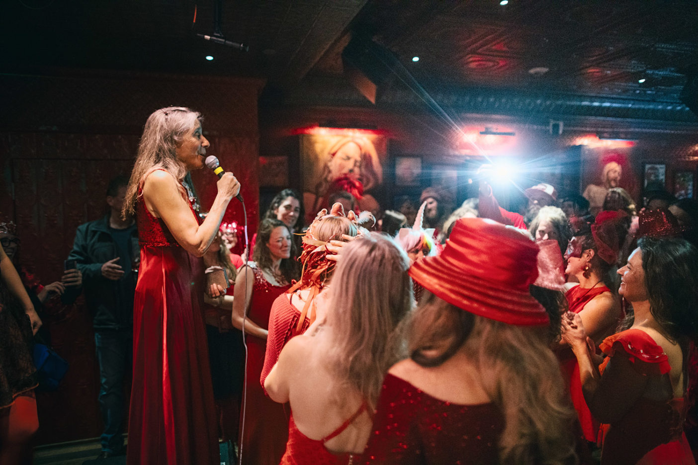 Sue Navy (Red Lady #11) has been actively involved in opposing the mine on Red Lady since 1977. At the 2019 Red Lady Salvation Ball in early March, the crowd excitedly awaits her announcement of who will be crowned Red Lady #42. Photo: Forest Woodward