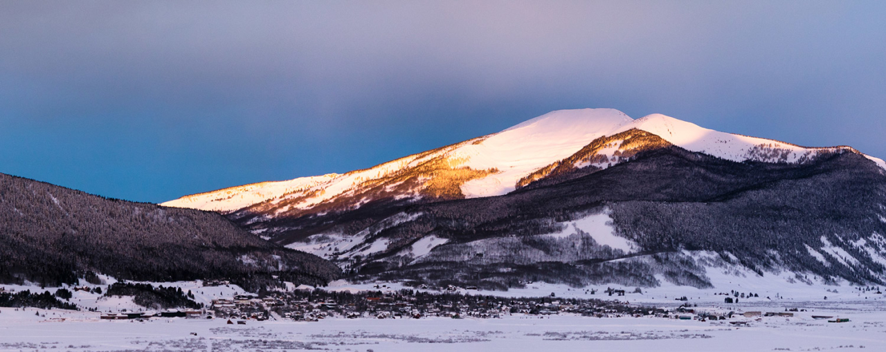 Red Lady peers down from 12,343 feet onto Crested Butte. Once the summer landing zone for the Ute Indians, she shares a similar story with other rural Coloradan outposts: economies of mining, ranching and, now, tourism. Photo: Forest Woodward