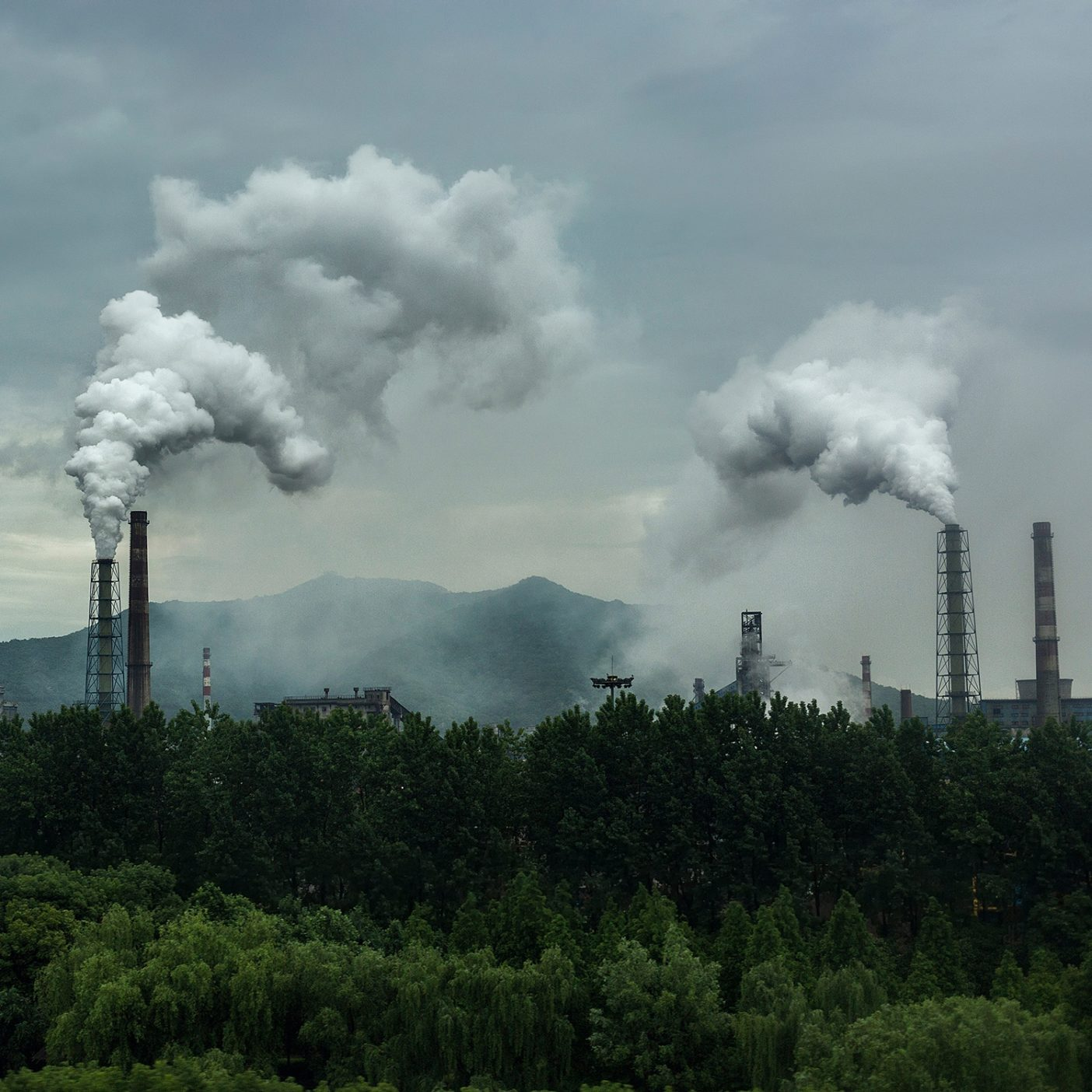 The clothing industry generates up to 10% of global emissions every year, contributing to the climate crisis. Patagonia is committed to lowering our impact and a big part of that is talking to our partners across the supply chain about switching to renewable energy sources. Smoke coming from industry in Hangzhou, China. Photo: Xia Yuan/Getty Images