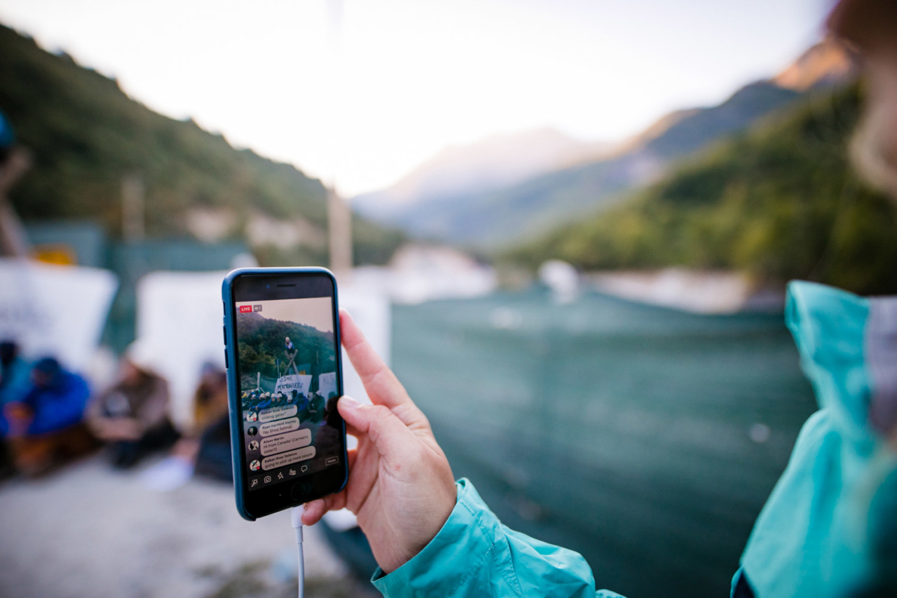 Going live for the world to see. We blocked the gate to an illegal building site of a dam project in Valbona Valley, Albania, during the third Balkan Rivers Tour in September 2018. Photo: Katja Jemec