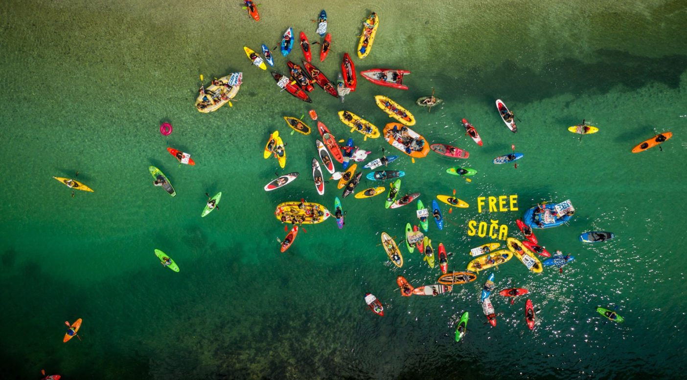 Free Soča flotilla during the fourth Balkan Rivers Tour in summer 2019 on our home river, Soča, Slovenia. A total of 150 paddlers from 23 countries joined on the reservoir behind the first of seven hydropower dams asking for the removal of the dam to expose the beautiful canyon below. Photo: Mitja Legat