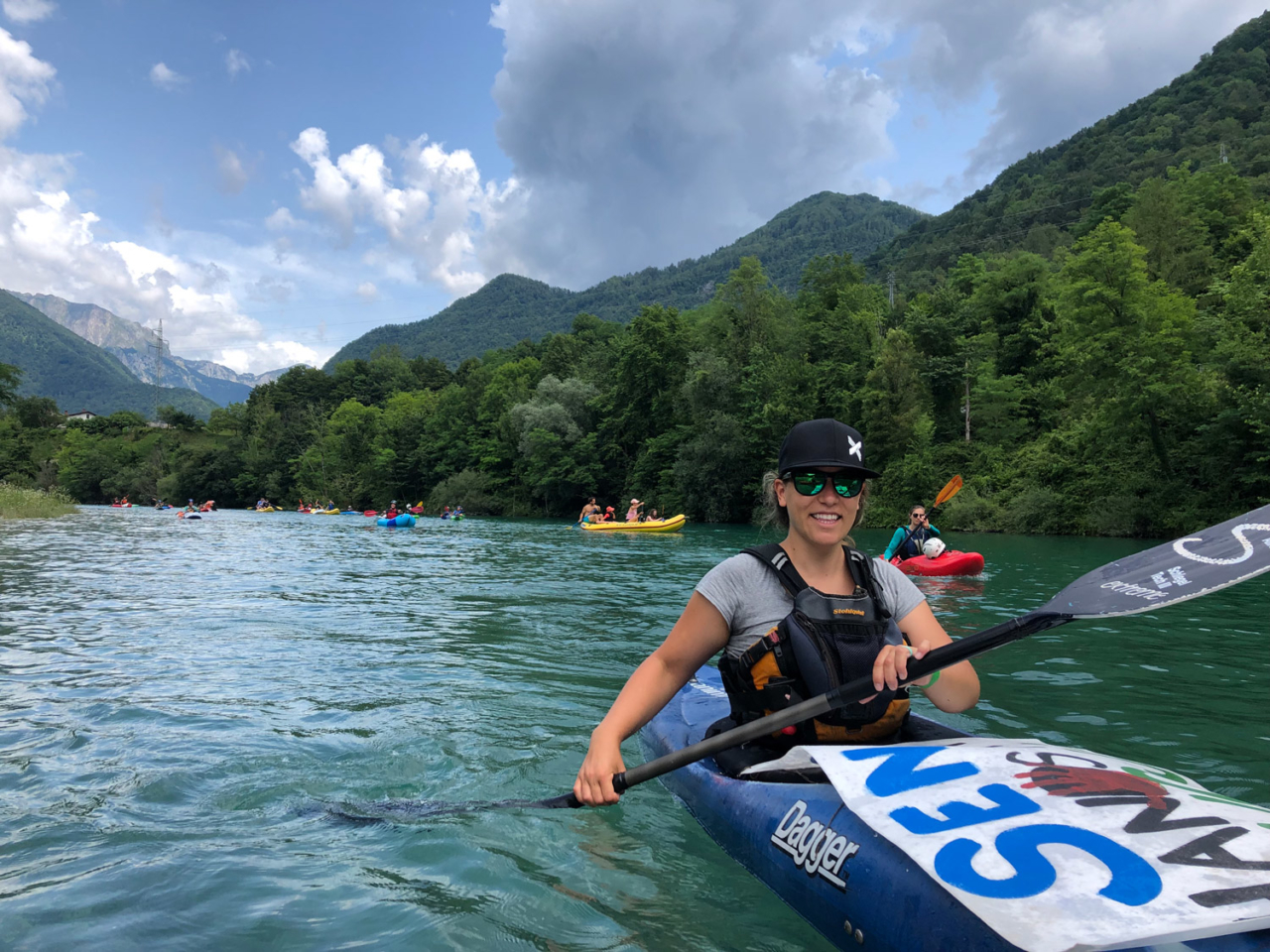 Paddling with 150 other river-lovers from our base camp to a reservoir at Most na Soči, where we held the Free Soča flotilla asking for the removal of a dam on this emerald beauty and setting a new standard for Balkan rivers. Photo: Primož Knap