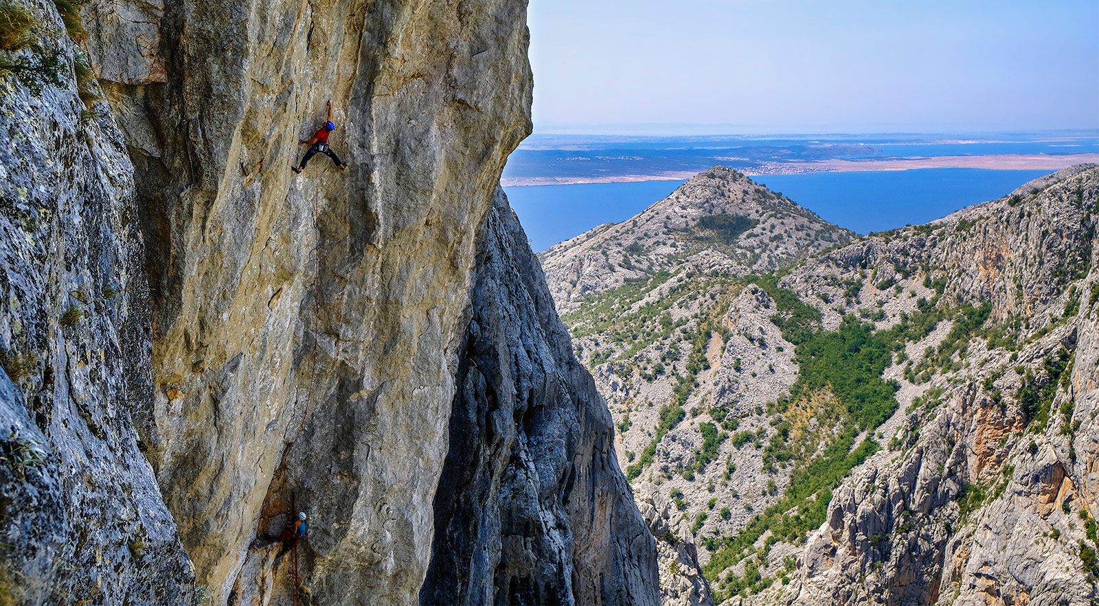 Amazing climbing on sharp limestone in the morning, warm Adriatic Sea and cold beer in the afternoon. Does it get any better? Luka Krajnc makes the first free ascent of Spomin. Paklenica National Park, Croatia. MARKO PREZELJ